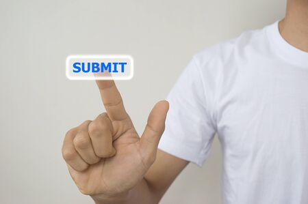 submit button: a man using digital interface with his fingers submit button