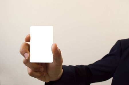 man holding card: business man holding card