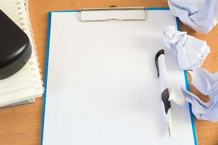 worktable: Worktable covered with blank document and pen Stock Photo
