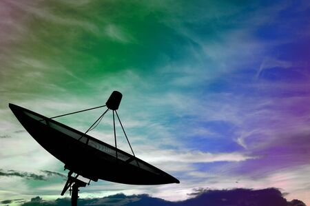 data transmission: Satellite dish transmission data on colorful cloudy Stock Photo