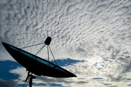 data transmission: Satellite dish transmission data on clounds background