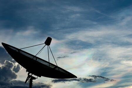 microwave antenna: Satellite dish transmission data on colorful sky background