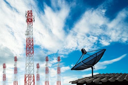 satellite tv: six telecommunications tower with satellite dish on roof