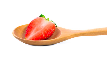 Strawberry in wood spoon isolated on white background, Strawberrys half.