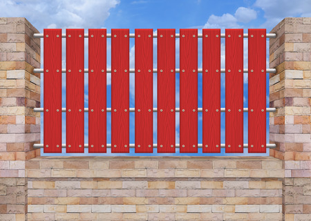picket: Red picket fence, brick wall. Stock Photo
