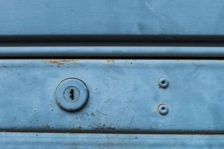 rolling garage door: Metal rolling door keyhole