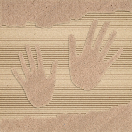 corrugated cardboard: Two hand cut out on a corrugated cardboard Stock Photo