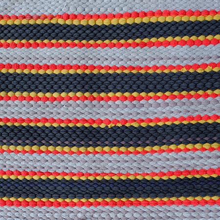 wool fiber: carpet background or texture with stripes in many colors