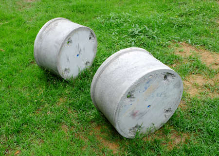 culvert: Concrete pipes on the grass Stock Photo