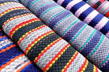 synthetic fiber: carpet background or texture with stripes in many colors