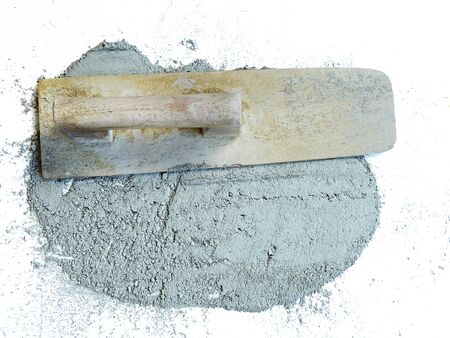 Cement trowel and cement powder on white background