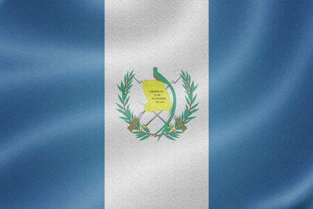bandera de guatemala: Bandera de Guatemala en el fondo de textura de tela Foto de archivo