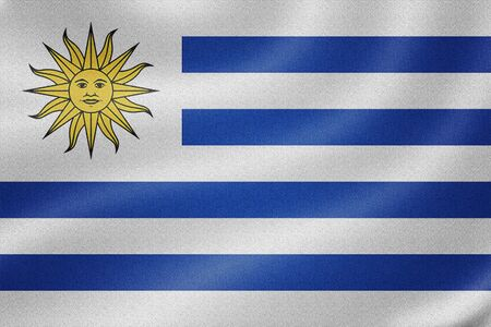 uruguay flag: Uruguay flag on the fabric texture background Stock Photo