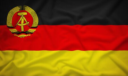east germany: East Germany merchant 1959-1973 flag on the fabric texture background,Vintage style Stock Photo