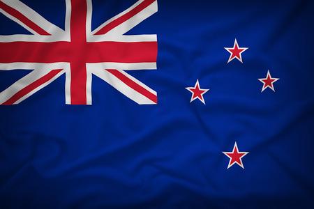 bandera de nueva zelanda: Bandera de Nueva Zelanda en el fondo de textura de tela, estilo vintage