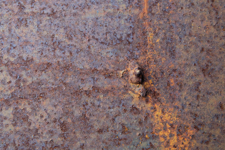 strongly: rusty on steel wall background