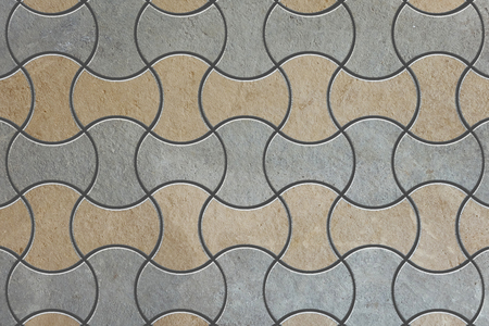 truncated: Gray and Brown Figured Pavement as Truncated Circle Stock Photo