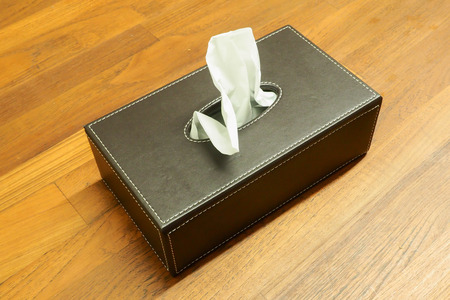 tissues: Box of tissues paper on wooden table