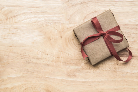 Gifts for special moments flat lay with copy space on wooden background