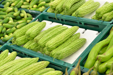 bitter melon: Bitter Melon And Vegetables At Market Stock Photo