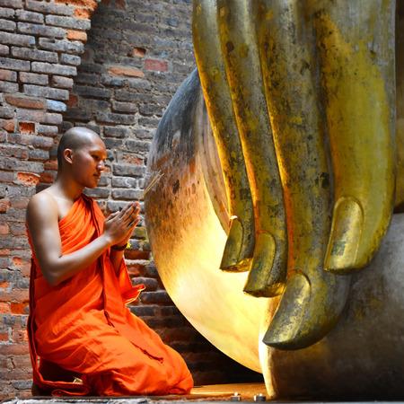 chanting: Buddhist monk praying At The National Historical Park, Sukhothai