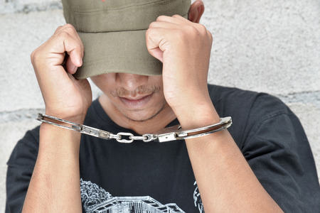 illegality: Man in handcuffs