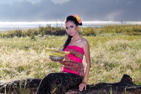 Woman during performed Melasti Ritual.