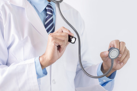 Doctor with stethoscope and flashlight