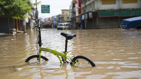 Bicycle in flooded water Reklamní fotografie