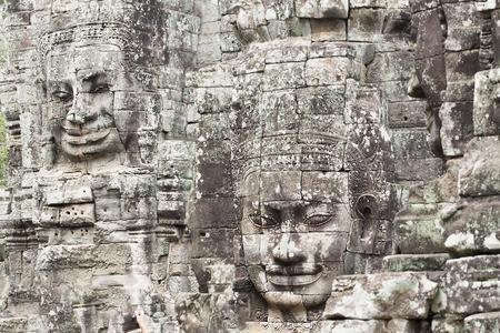 Stone Carvings of Buddha Faces on Bayon Temple at Historic Angkor Wat, Cambodia