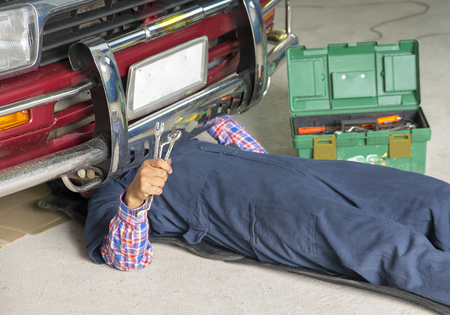 Auto mechanic repair engine in a car repair