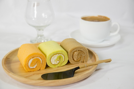 Roll Cake with on Wooden Plate