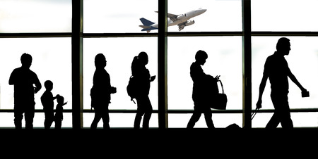 Silhouette of Travellers backpack into an Airport. Reklamní fotografie - 105983575