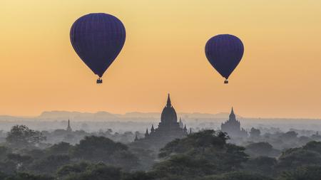 Hot air balloons at dawn over Bagan temples, Myanmar