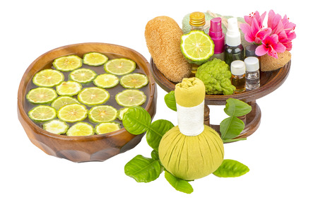 Natural Spa ingredients and bottle of herbal extract oil for alternative medicine and aromatherapy. Thai Spa theme with ayurvedic therapist on shabby on white background Reklamní fotografie - 105983648