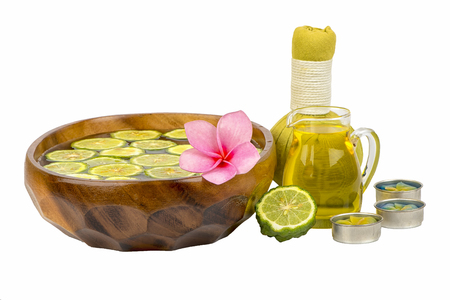Natural Spa ingredients and bottle of herbal extract oil for alternative medicine and aromatherapy. Thai Spa theme with ayurvedic therapist on shabby on white background
