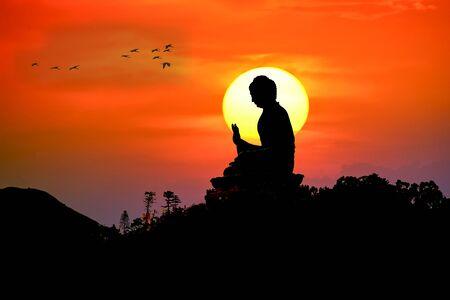 Silhouette of Tian Tan Buddha or Giant Buddha statue at Po Lin Monastery Ngong Ping, Lantau Island, Hong Kong, China