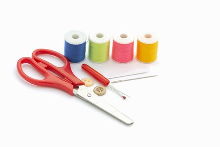 Multi-colored thread,Scissors, sewing needle, tape measure,thread picker clothing repair concept