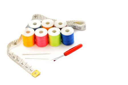 Multi-colored thread,Scissors, sewing needle, tape measure,thread picker clothing repair concept.