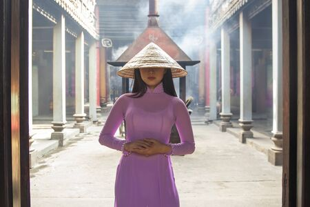 Beautiful women with Vietnam culture traditional dress, Ao dai is famous traditional costume , Ho Chi minh Vietnam.