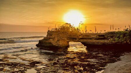 Sunset over hindu temple Pura Tanah Lot, Bali, Indonesia