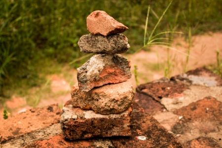 archaeological site: sort old red bricks isolated on Archaeological site background