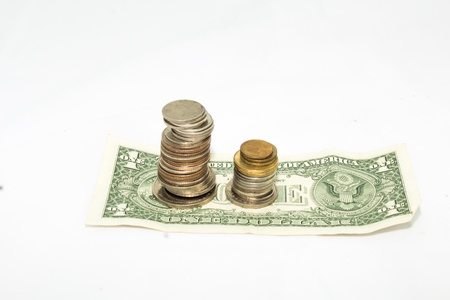 frugal: Monetary coin and cash on white background