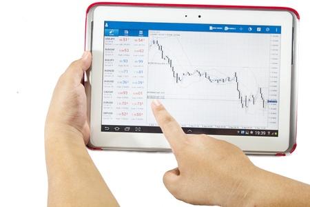 fumigador: Gráfico de la bolsa en un equipo Tablet PC