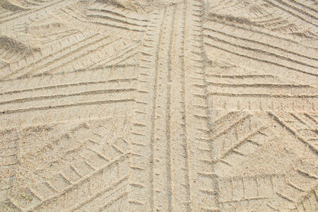 Detail of tyre tracks in sand desert photo