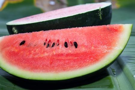 Watermelon isolated on banana leaf