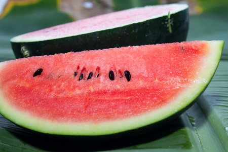 Watermelon isolated on banana leaf