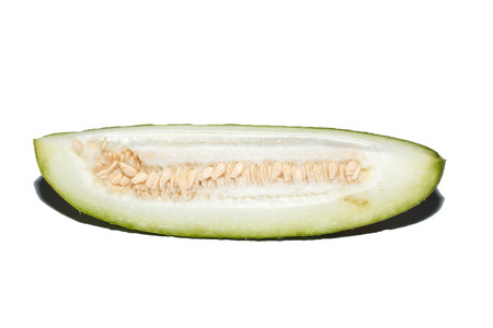 cutting Asian wax squash isolated on white background  photo