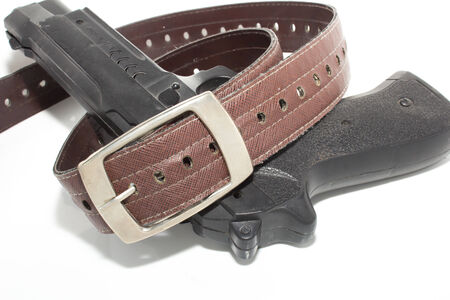 And gun belts isolate on the white photo