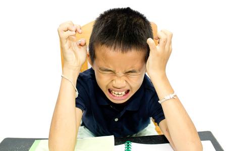Boy stress doing homework on a desk